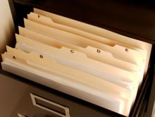 Filing cabinet with open drawer